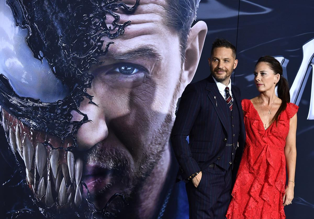 Tom Hardy, Kelly Marcel attend the Premiere Of Columbia Pictures' 'Venom' at Regency Village Theatre on October 1, 2018 in Westwood, California.