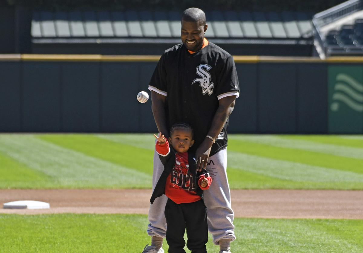 Kanye West and his son Saint throw out a ceremonial first pitch before the game between the Chicago White Sox and the Chicago Cubs on September 23, 2018 at Guaranteed Rate Field in Chicago, Illinois.