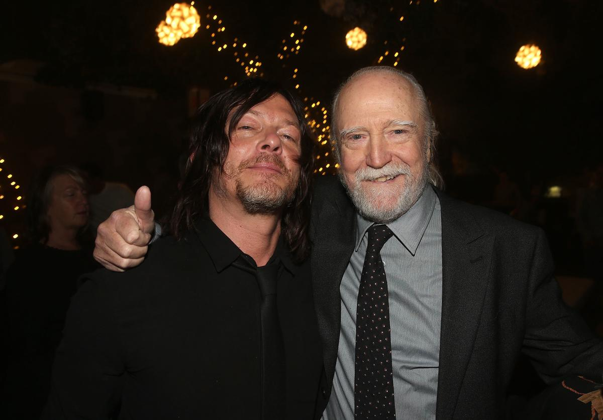 Norman Reedus (L) and Scott Wilson attend The Walking Dead 100th Episode Premiere and Party on October 22, 2017 in Los Angeles, California.