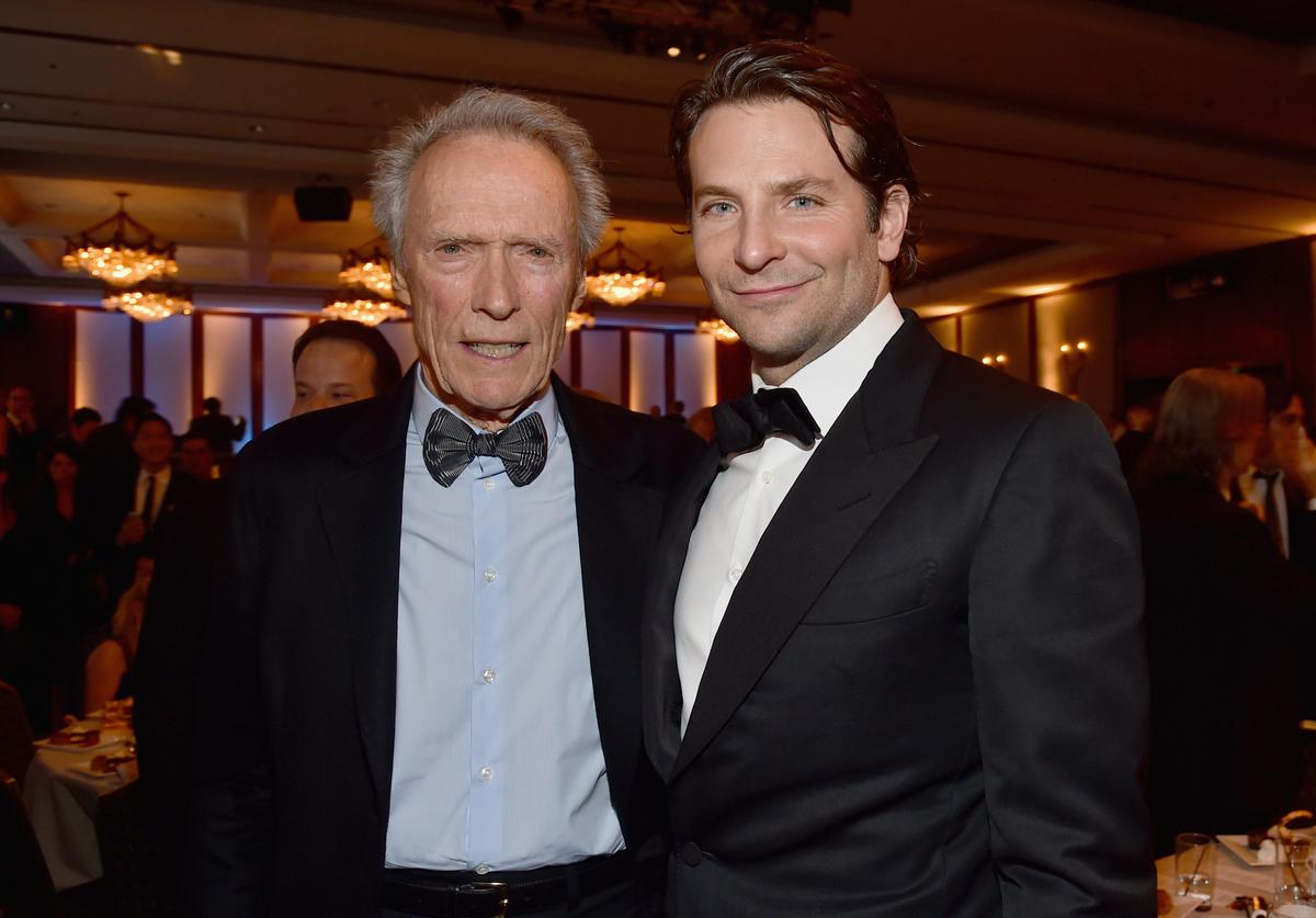 Actor/director Clint Eastwood (L) and actor Bradley Cooper attend the 67th Annual Directors Guild Of America Awards at the Hyatt Regency Century Plaza on February 7, 2015 in Century City, California.