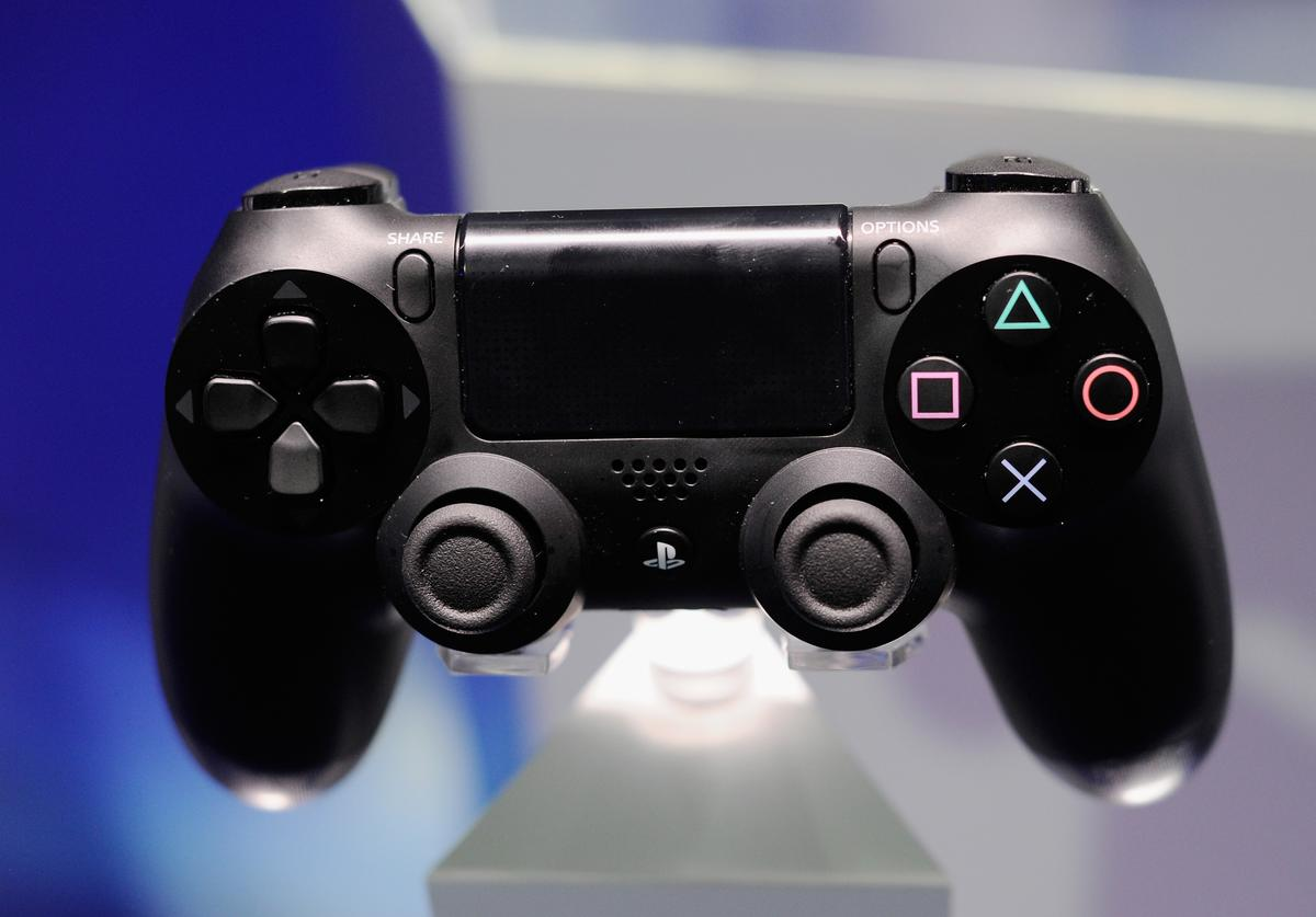 A Playstation 4 and its controller is on display at the Sony Playstation E3 2013 booth at the Los Angeles Convention Center on June 11, 2013 in Los Angeles, California.