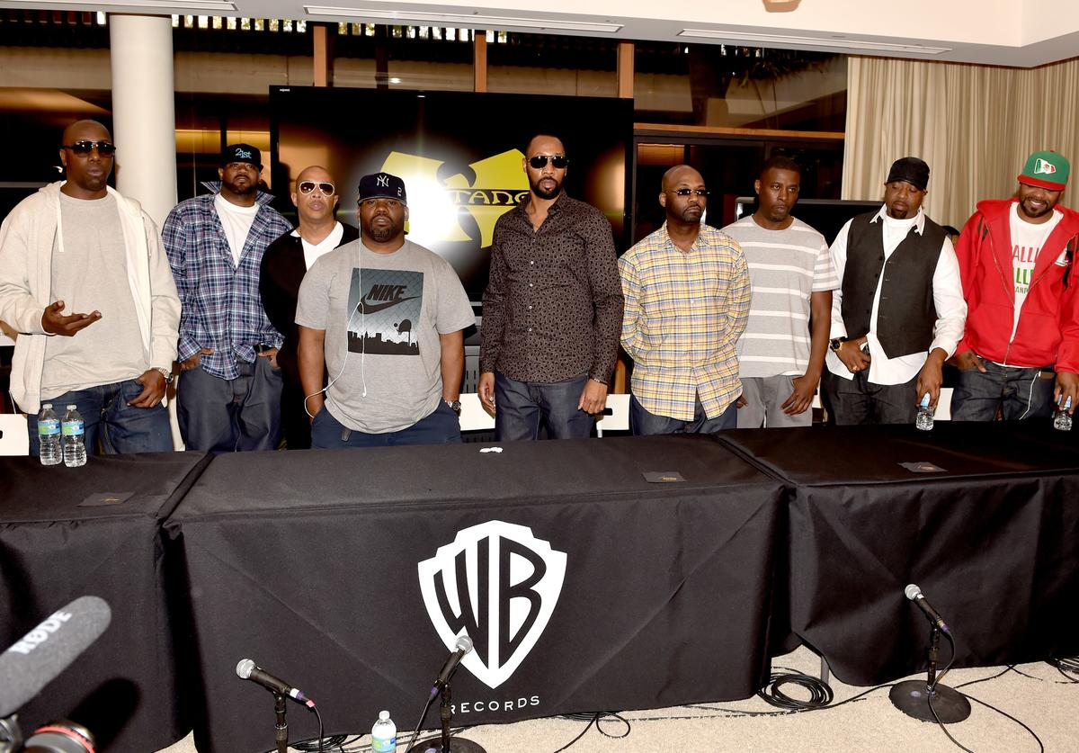 Rappers Inspectah Deck, Ghostface Killah, U-God, Raekwon, RZA, Masta Killa, GZA, Cappadonna and Method Man of the Wu-Tang Clan pose at a press conference to announce they have signed with Warner Bros. Records at Warner Bros. Records on October 2, 2014 in Burbank, California.
