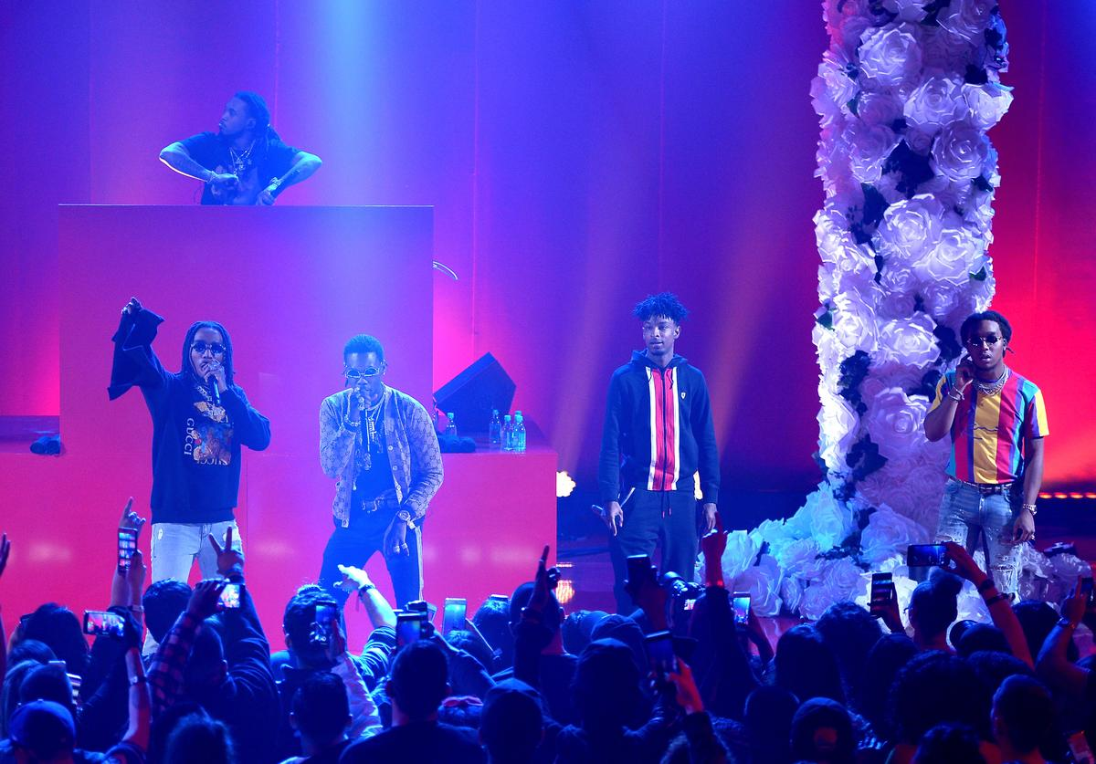 Quavo, Offset, 21 Savage, and Takeoff perform onstage at iHeartRadio album release party with Migos presented by MAGNUM Large Size Condoms at iHeartRadio Theater on January 22, 2018 in Burbank, California