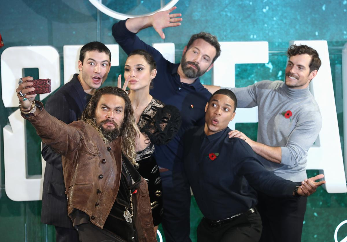 Actors Jason Momoa, Ezra Miller, Gal Gadot, Ben Affleck, Ray Fisher and Henry Cavill attend the 'Justice League' photocall at The College on November 4, 2017 in London, England.