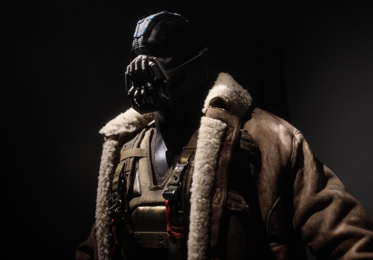 A Bane costume from the 2012 Dark Knight Rises film worn by Tom Hardy and designed by Lindy Hemming is on display at the DC Comics Exhibition: Dawn Of Super Heroes at the O2 Arena on February 22, 2018 in London, England.