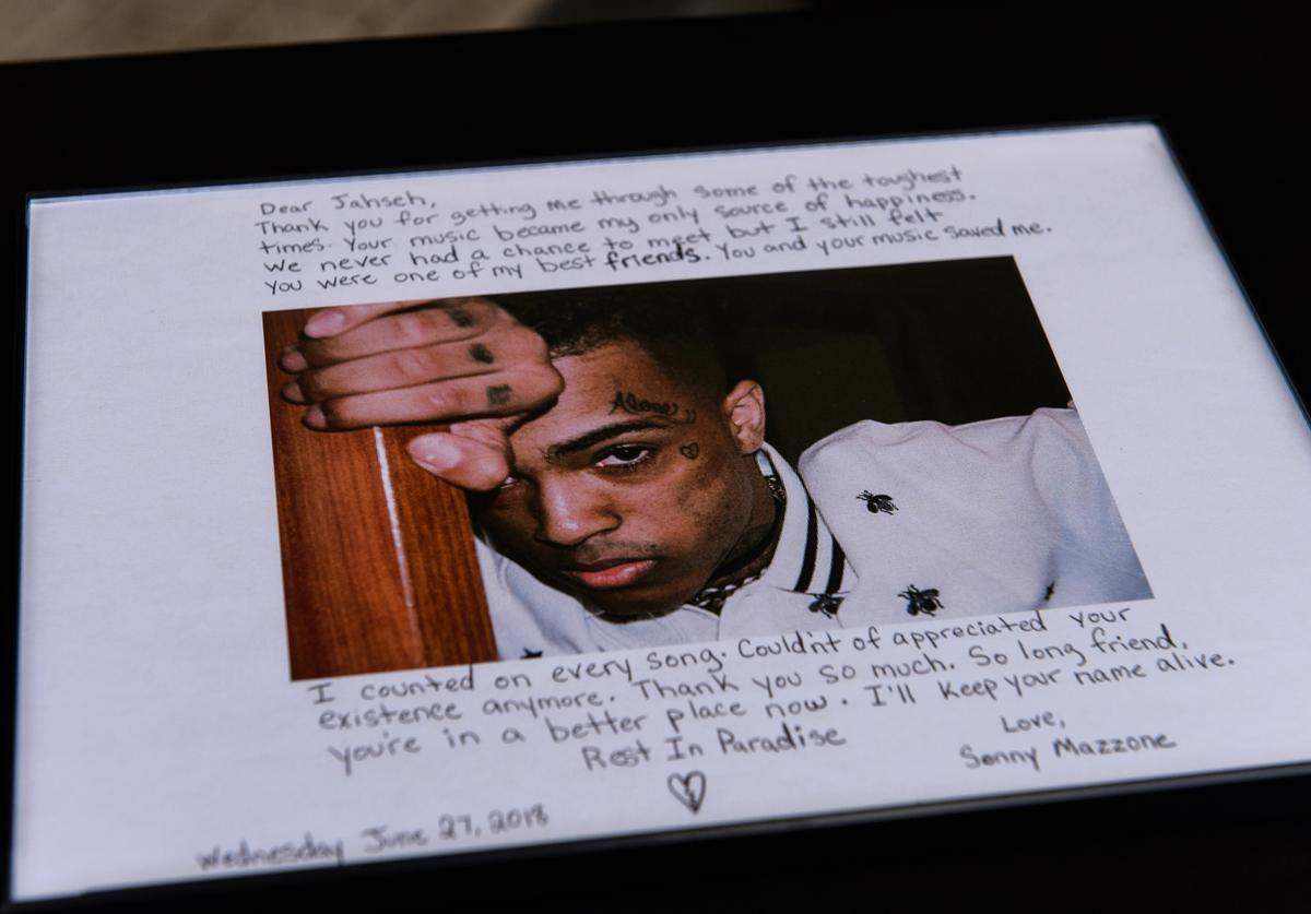 Fans leave art outside the XXXTentacion Funeral & Fan Memorialat BB&T Center on June 27, 2018 in Sunrise, Florida.