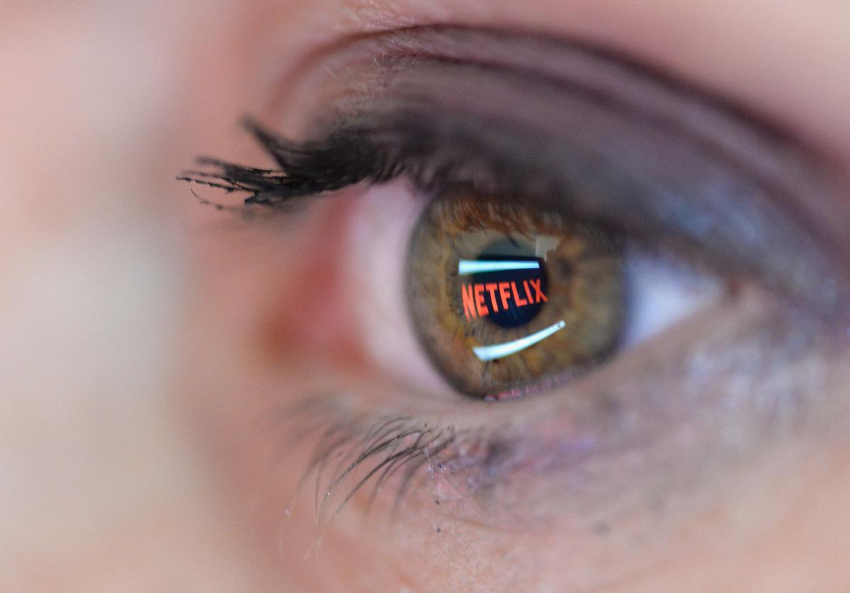 In this photo illustration the Netflix logo is reflected in the eye of a woman on September 19, 2014 in Paris, France. Netflix September 15 launched service in France, the first of six European countries planned in the coming months.