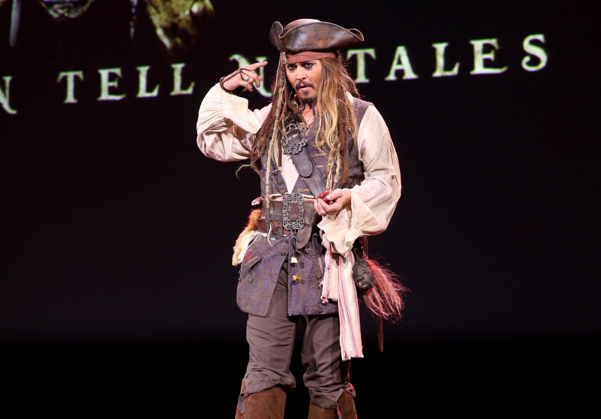Actor Johnny Depp, dressed as Captain Jack Sparrow, of PIRATES OF THE CARIBBEAN: DEAD MEN TELL NO TALES took part today in 'Worlds, Galaxies, and Universes: Live Action at The Walt Disney Studios' presentation at Disney's D23 EXPO 2015 in Anaheim, Calif.