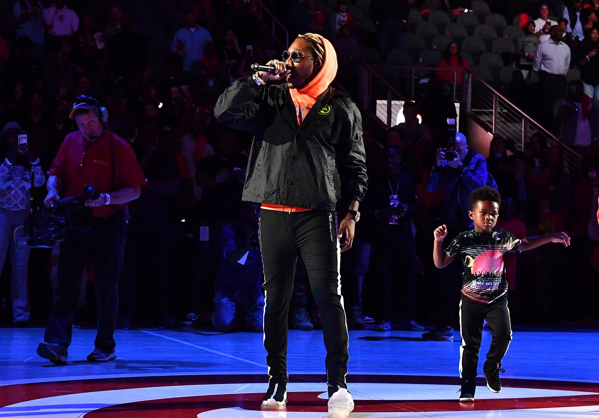 Rapper Future performs in concert with his son Future Zahir Wilburn (R) after the game between the Dallas Mavericks and the Atlanta Hawks on October 24, 2018 at State Farm Arena in Atlanta, Georgia.
