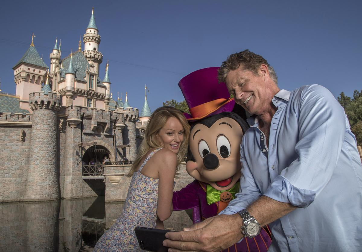 In this handout image provided by Disney Parks, David Hasselhoff (L) and wife Hayley Roberts visit Halloween Time at Disneyland for Roberts' birthday on Sept. 19, 2018 in Anaheim, California. Halloween Time at Disneyland Resort takes place through October 31.