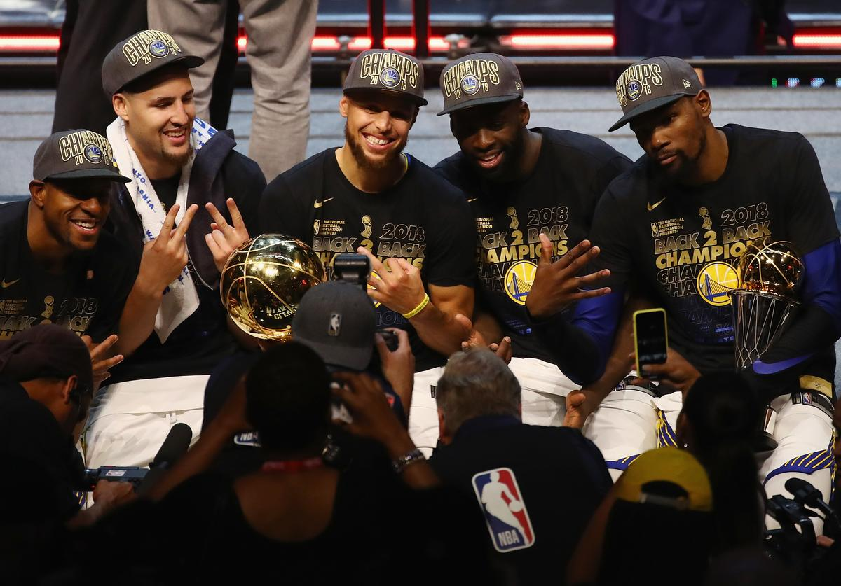 Andre Iguodala #9, Klay Thompson #11, Stephen Curry #30, Draymond Green #23 and Kevin Durant #35 of the Golden State Warriors celebrate after defeating the Cleveland Cavaliers during Game Four of the 2018 NBA Finals at Quicken Loans Arena on June 8, 2018 in Cleveland, Ohio. The Warriors defeated the Cavaliers 108-85 to win the 2018 NBA Finals. NOTE TO USER: User expressly acknowledges and agrees that, by downloading and or using this photograph, User is consenting to the terms and conditions of the Getty Images License Agreement.