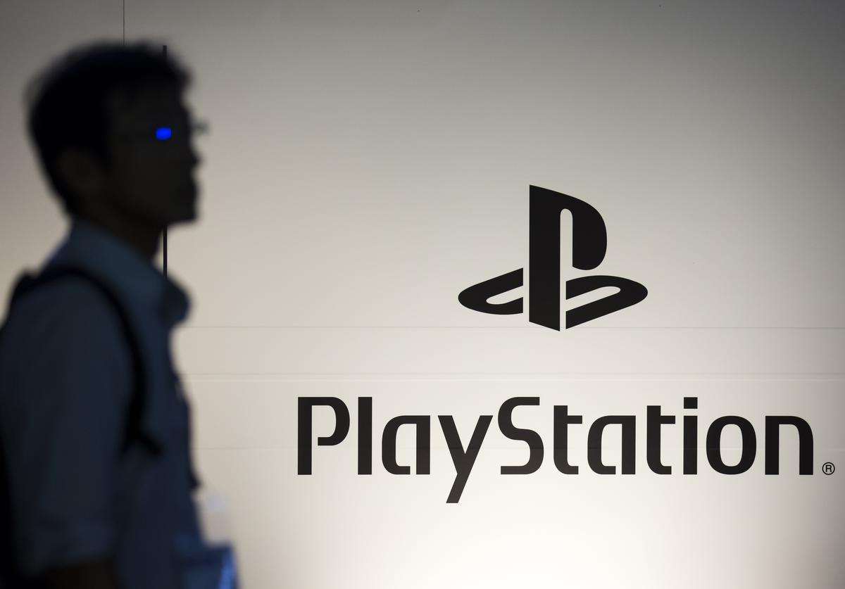An attendee walks past the PlayStation logo in the Sony Interactive Entertainment booth during the Tokyo Game Show 2018 on September 20, 2018 in Chiba, Japan. The Tokyo Game Show is held from September 20 to 23, 2018.