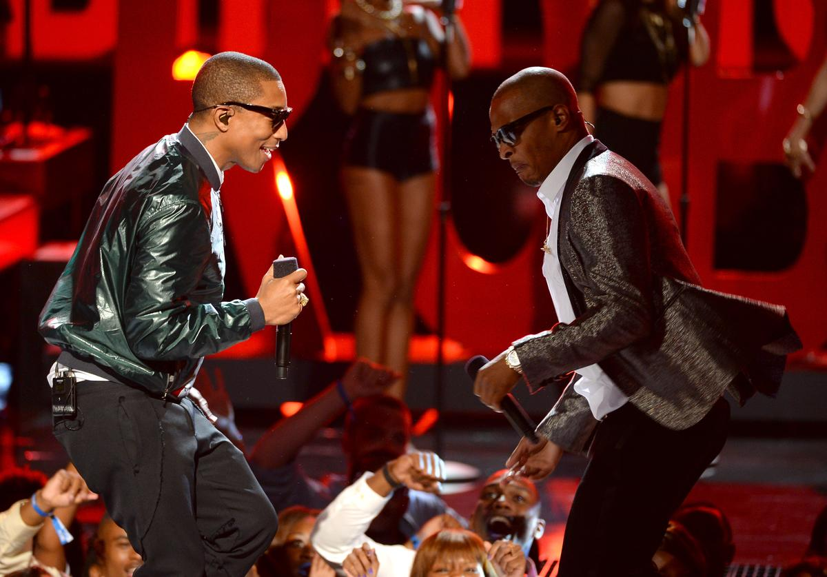 Pharrell Williams (L) and T.I. perform onstage during the 2013 BET Awards at Nokia Theatre L.A. Live on June 30, 2013 in Los Angeles, California