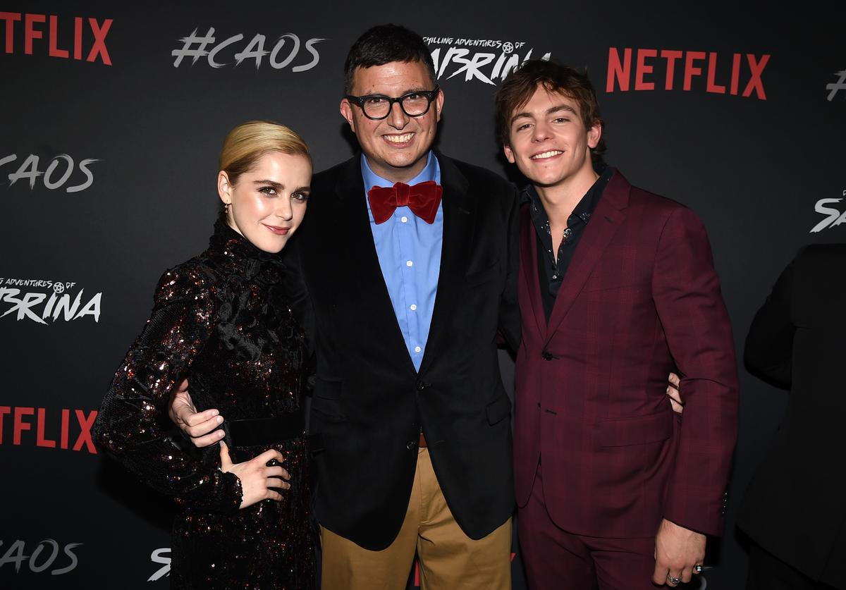 Kiernan Shipka, Roberto Aguirre-Sacasa and Ross Lynch arrive at the premiere of Netflix's 'Chilling Adventures Of Sabrina' at the Hollywood Athletic Club on October 19, 2018 in Los Angeles, California