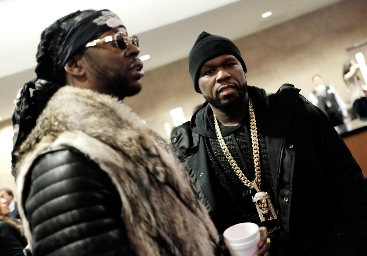 2 Chainz (L) and 50 Cent attend Kanye West Yeezy Season 3 on February 11, 2016 in New York City