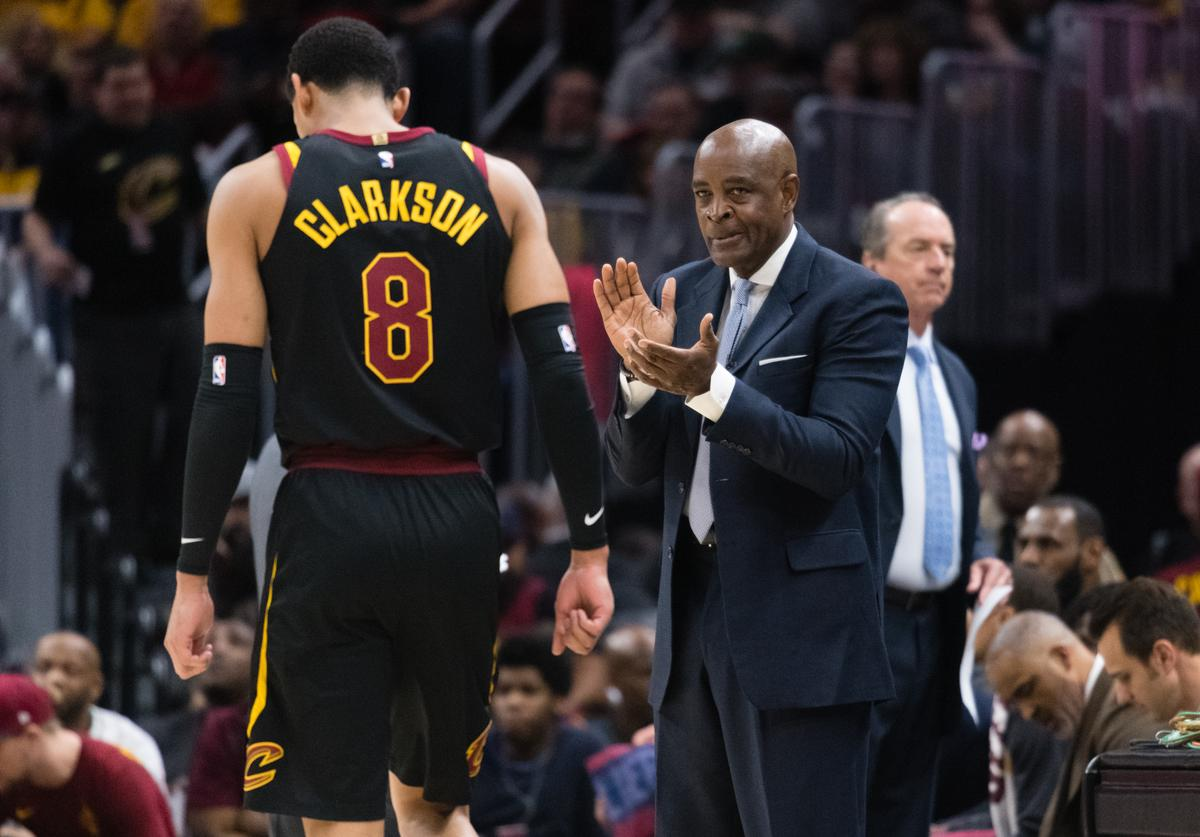 Jordan Clarkson #8 of the Cleveland Cavaliers #2 leaves the game as interim head coach Larry Drew of the Cleveland Cavaliers looks on during the first half against the Milwaukee Bucks at Quicken Loans Arena on March 19, 2018 in Cleveland, Ohio.
