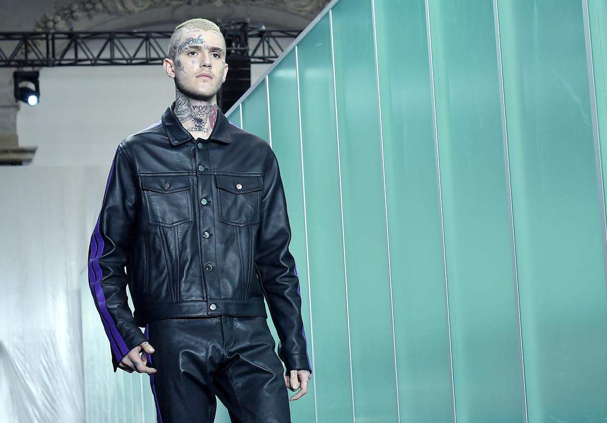 Lil Peep walks the runway during the Vlone Menswear Spring/Summer 2018 show as part of Paris Fashion Week on June 23, 2017 in Paris, France