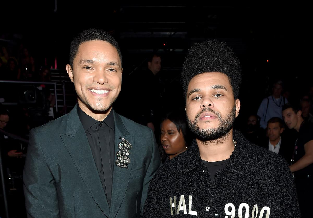 Trevor Noah and The Weeknd attend the 2018 Victoria's Secret Fashion Show in New York at Pier 94 on November 8, 2018 in New York City
