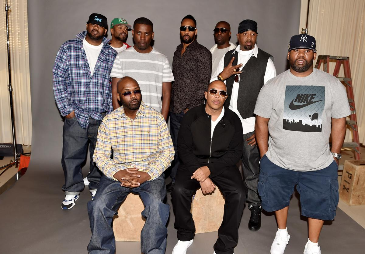 Rappers Ghostface Killah, Method Man, GZA, RZA, Inspectah Deck, Cappadonna, Raekwon, (L-R, seated), Masta Killa and U-God of the Wu-Tang Clan pose at a press conference to announce they have signed with Warner Bros. Records at Warner Bros. Records on October 2, 2014 in Burbank, California.