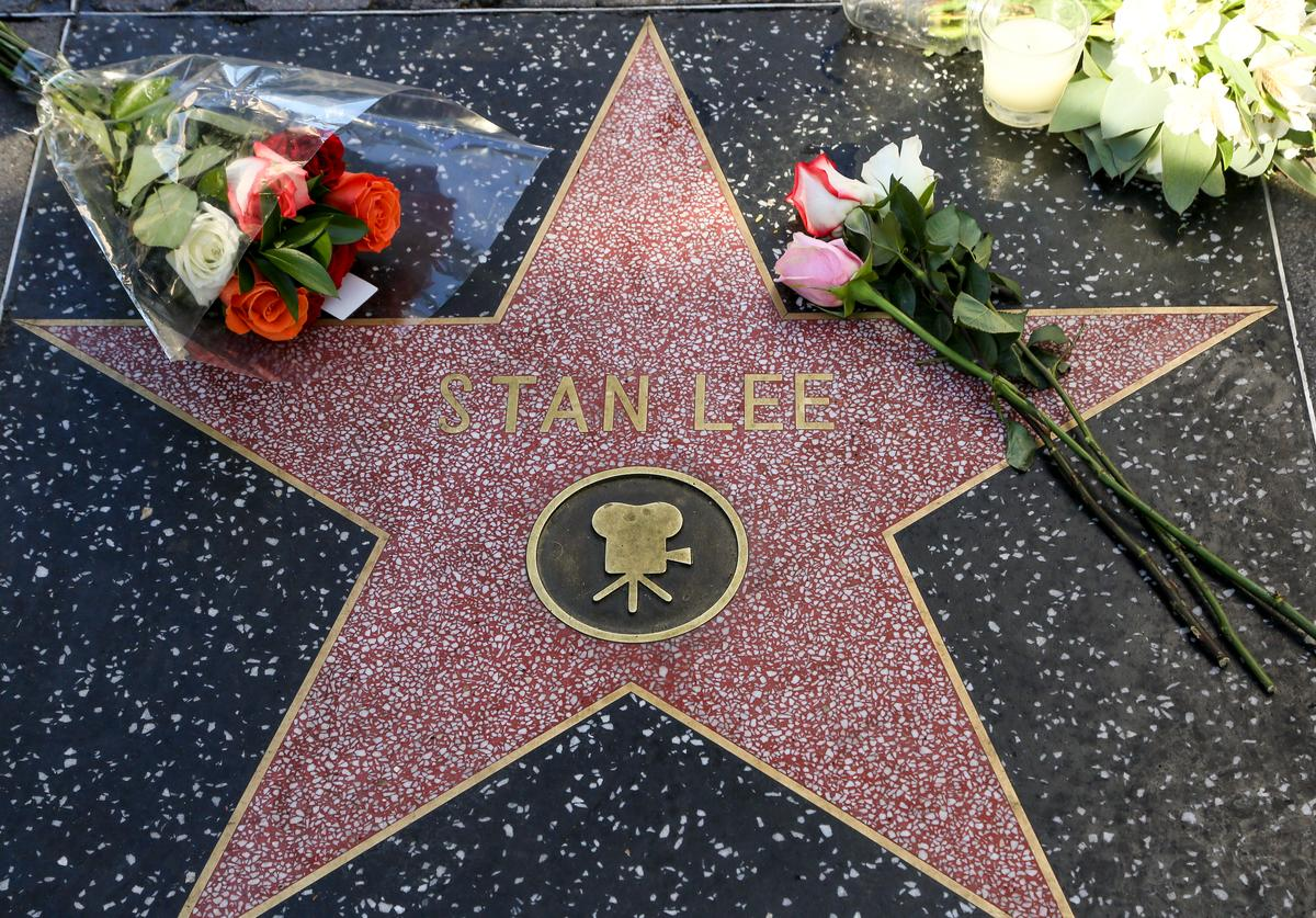 Fans leave tributes on Stan Lee's star on the Hollywood Walk of Fame shortly after the news that the Marvel founder died aged 95 was made public on November 12, 2018 in Los Angeles, California.