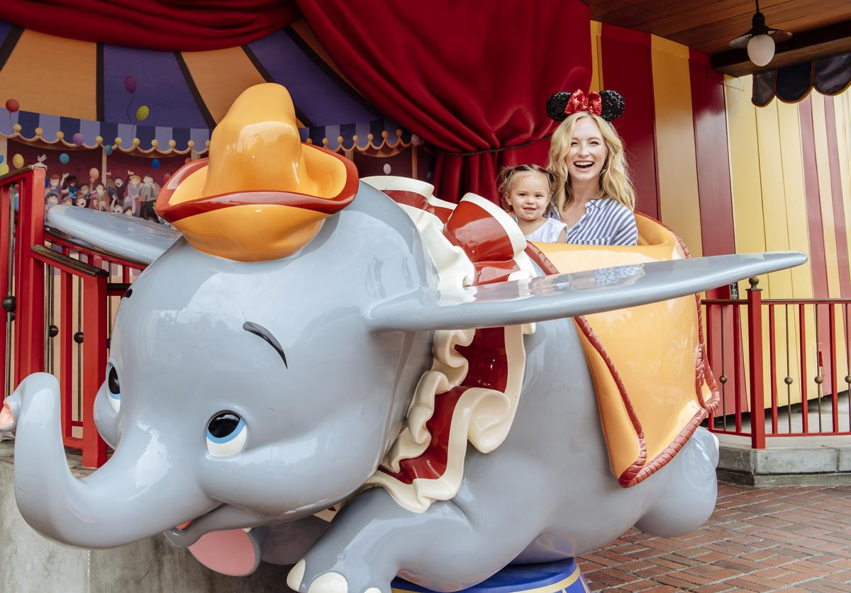 In this handout image provided by Disney, Actress Candice Accola shares a special moment with her daughter, Florence May, after taking flight on Dumbo The Flying Elephant at Magic Kingdom Park on June 14, 2017 in Lake Buena Vista, Florida. Accola spent time vacationing with family and friends at Walt Disney World Resort in between projects.