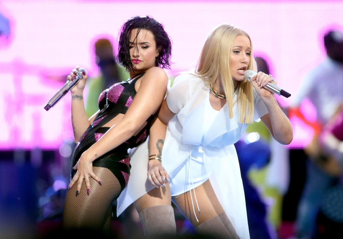 Demi Lovato (L) and Iggy Azalea perform on the Pepsi Stage, during the 2015 MTV Video Music Awards, at The Orpheum Theatre on August 30, 2015 in Los Angeles, California
