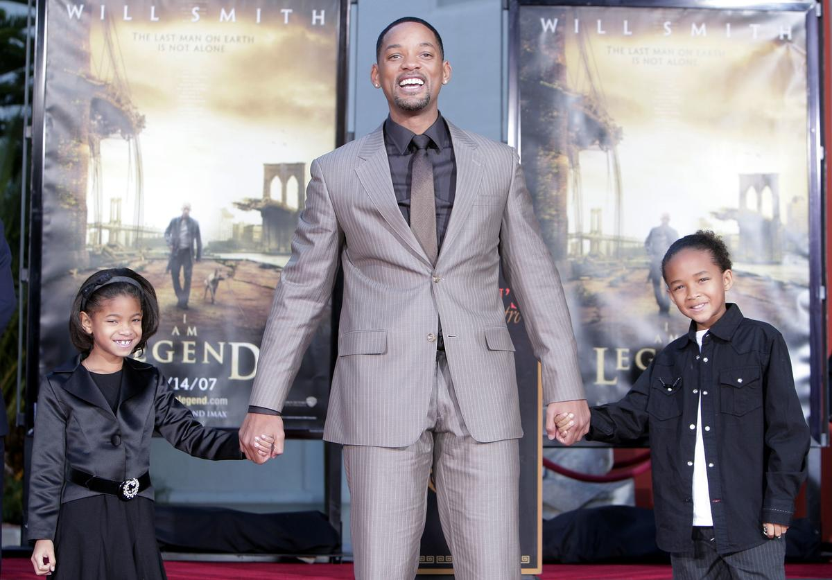Will Smith, poses with his children Willow (L) and Jaden (R), as he is honored with a hand and footprint ceremony at Grauman's Chinese Theatre December 10, 2007 in Los Angeles, California