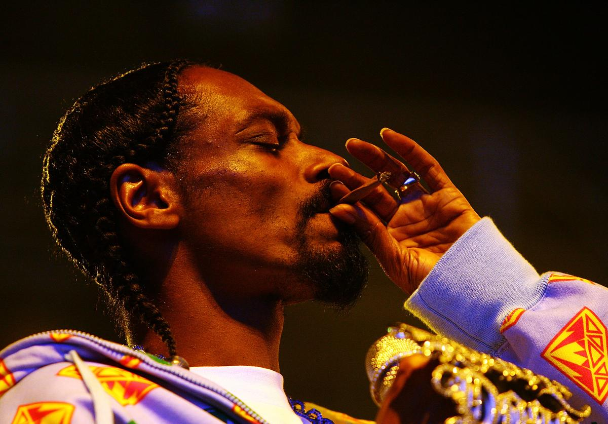 Snoop Dogg smokes a joint while performing at the Melbourne stop of the Good Vibrations Festival 2007 at the Sidney Myer Music Bowl on February 10, 2007 in Melbourne, Australia