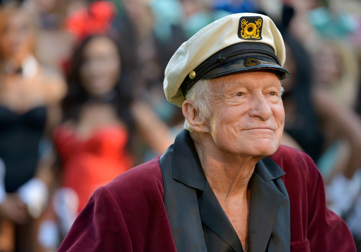 Hugh Hefner poses at Playboy's 60th Anniversary special event on January 16, 2014 in Los Angeles, California