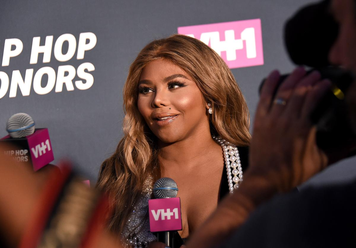 Rapper Lil Kim is interviewed on the carpet during the VH1 Hip Hop Honors: All Hail The Queens at David Geffen Hall on July 11, 2016 in New York City.
