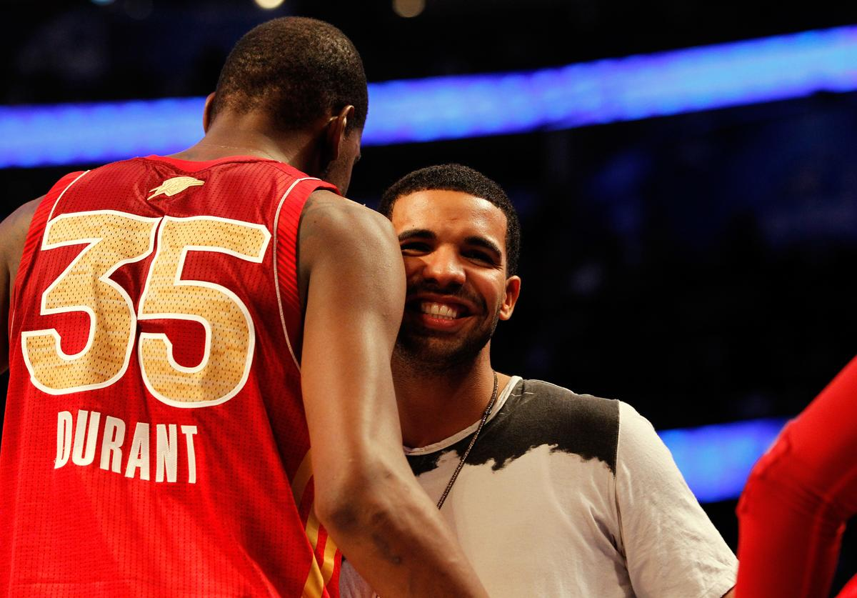 Drake greets Kevin Durant #35 of the Oklahoma City Thunder and the Western Conference during the 2012 NBA All-Star Game at the Amway Center on February 26, 2012 in Orlando, Florida