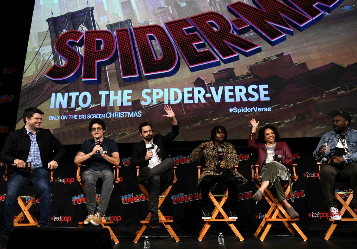 Directors Christopher Miller and Phil Lord , actors Jake Johnson, Shameik Moore, Lauren Vélez and Brian Tyree Henry speak onstage at the Spider-Man: Into the Spider-Verse Inside Look panel during New York Comic Con at The Hulu Theater at Madison Square Garden on October 6, 2018 in New York City.