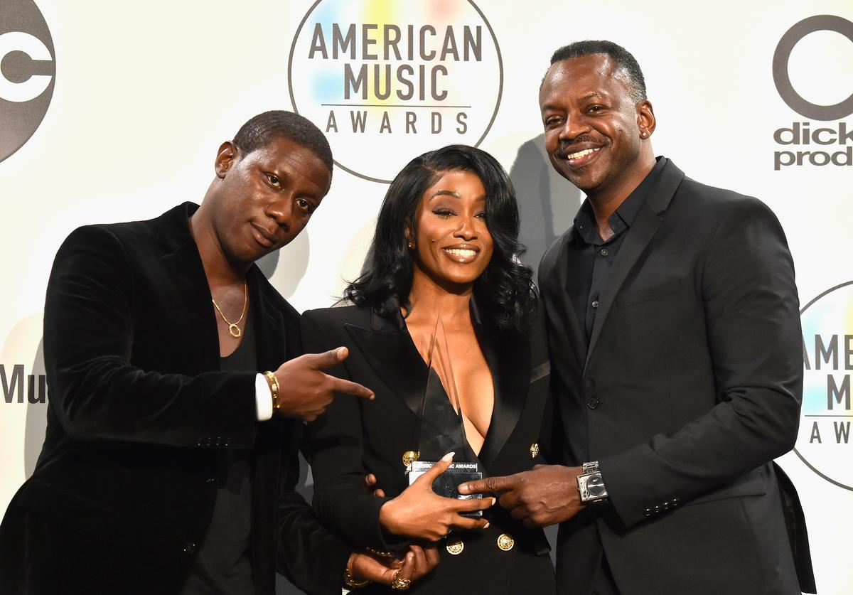 Cleopatra Bernard (C) and guests, who accepted the Favorite Album - Soul/R&B award for '17' on behalf of the late XXXTentacion, pose in the press room during the 2018 American Music Awards at Microsoft Theater on October 9, 2018 in Los Angeles, California
