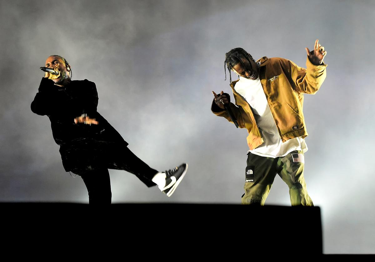Rappers Kendrick Lamar (L) and Travis Scott perform on the Coachella Stage during day 3 of the Coachella Valley Music And Arts Festival (Weekend 1) at the Empire Polo Club on April 16, 2017 in Indio, California.