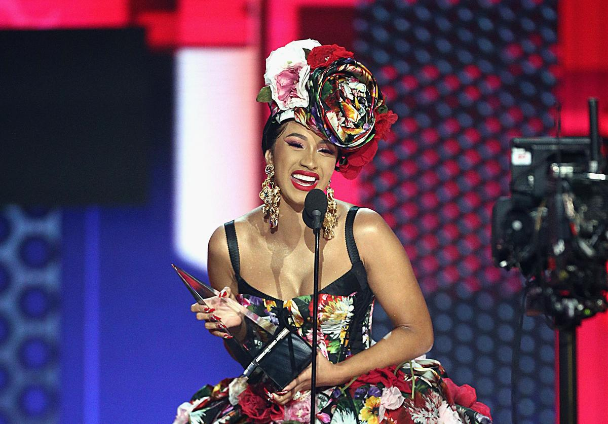 Cardi B accepts the Favorite Artist - Rap/Hip-Hop award onstage during the 2018 American Music Awards at Microsoft Theater on October 9, 2018 in Los Angeles, California