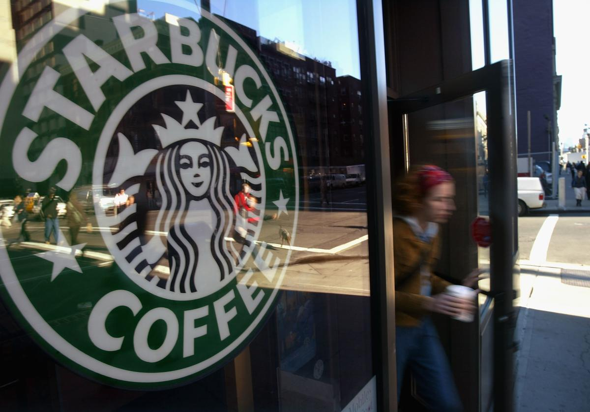 A person walks out of a Starbucks coffee shop October 5, 2004 in New York City