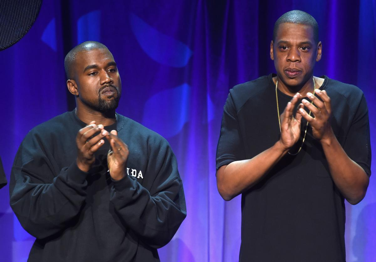 Kanye West (L) and JAY Z onstage at the Tidal launch event #TIDALforALL at Skylight at Moynihan Station on March 30, 2015 in New York City