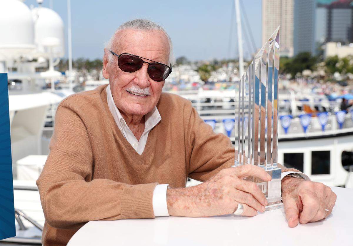 Stan Lee poses with the first-ever IMDb STARmeter Award for Lifetime Achievement on the #IMDboat At San Diego Comic-Con 2017 on the IMDb Yacht on July 21, 2017 in San Diego, California