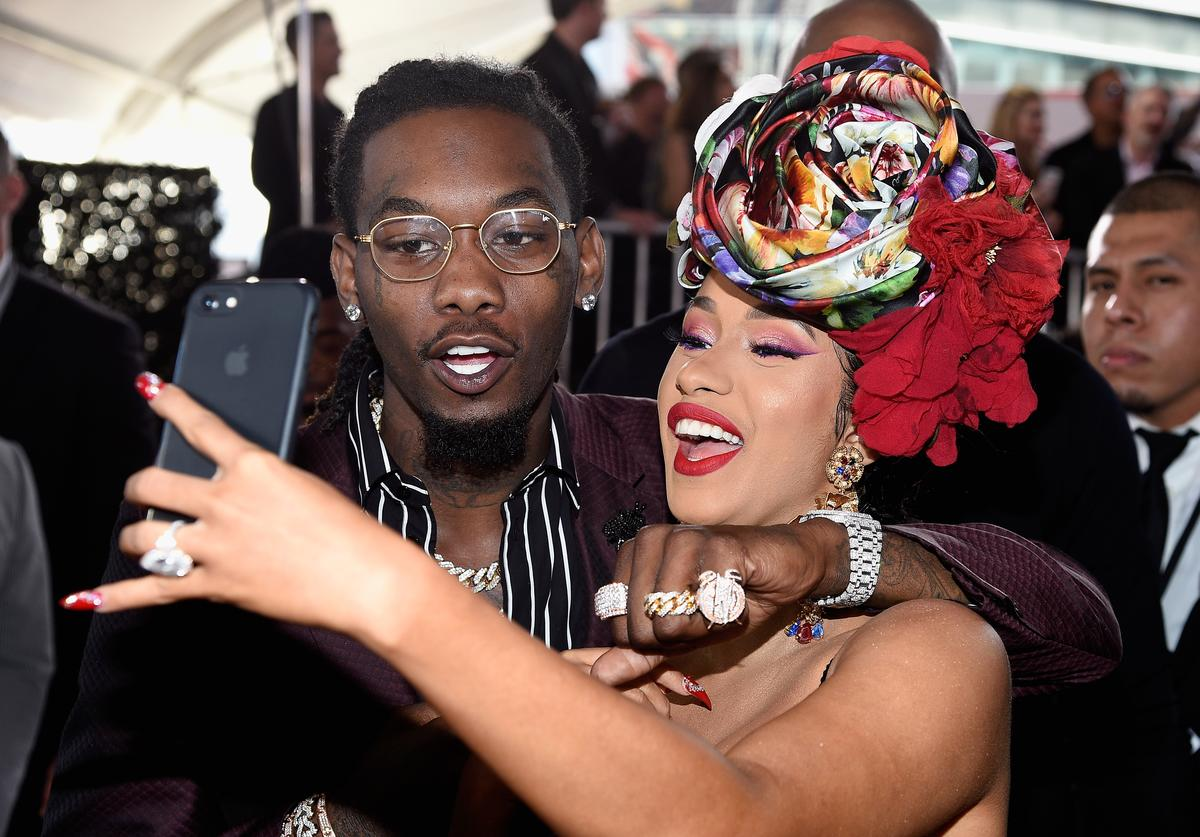 Cardi B and Offset looking at their phone together