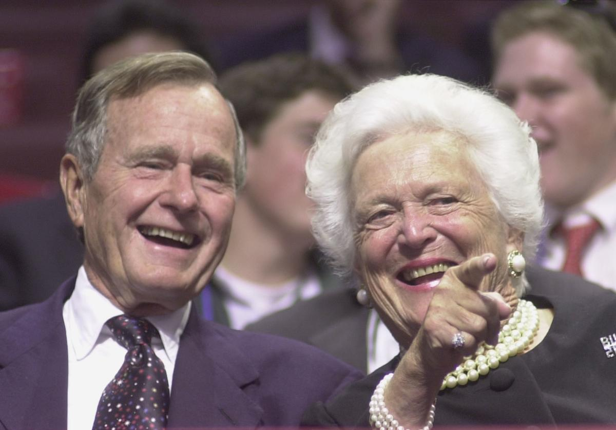 George and Barbara Bush point to well-wishers during the first day of the Republican National Convention, July 31, 2000 in Philadelphia.