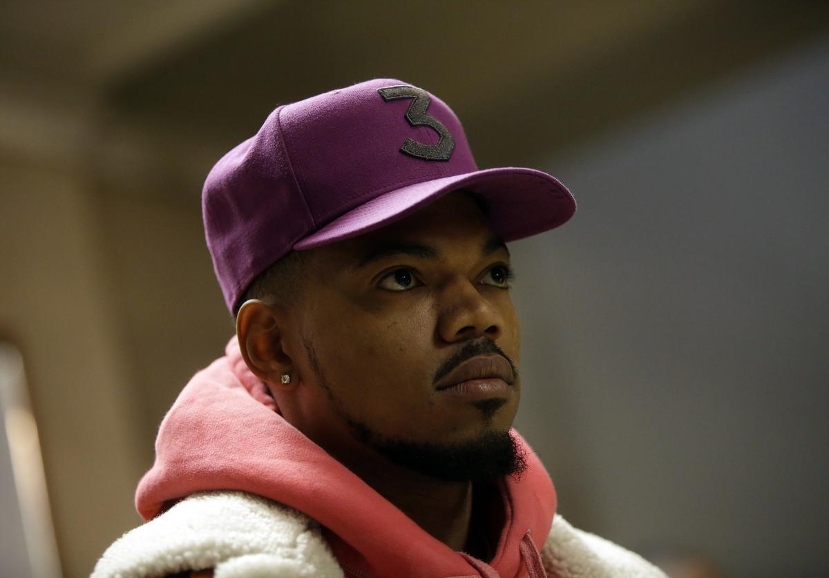 Music artist Chance The Rapper listens to a question during a news conference at City Hall on Tuesday, October 16, 2018 in Chicago, Illinois. Chance the Rapper announced his endorsement for Enyia and said she is the best candidate for Chicago.