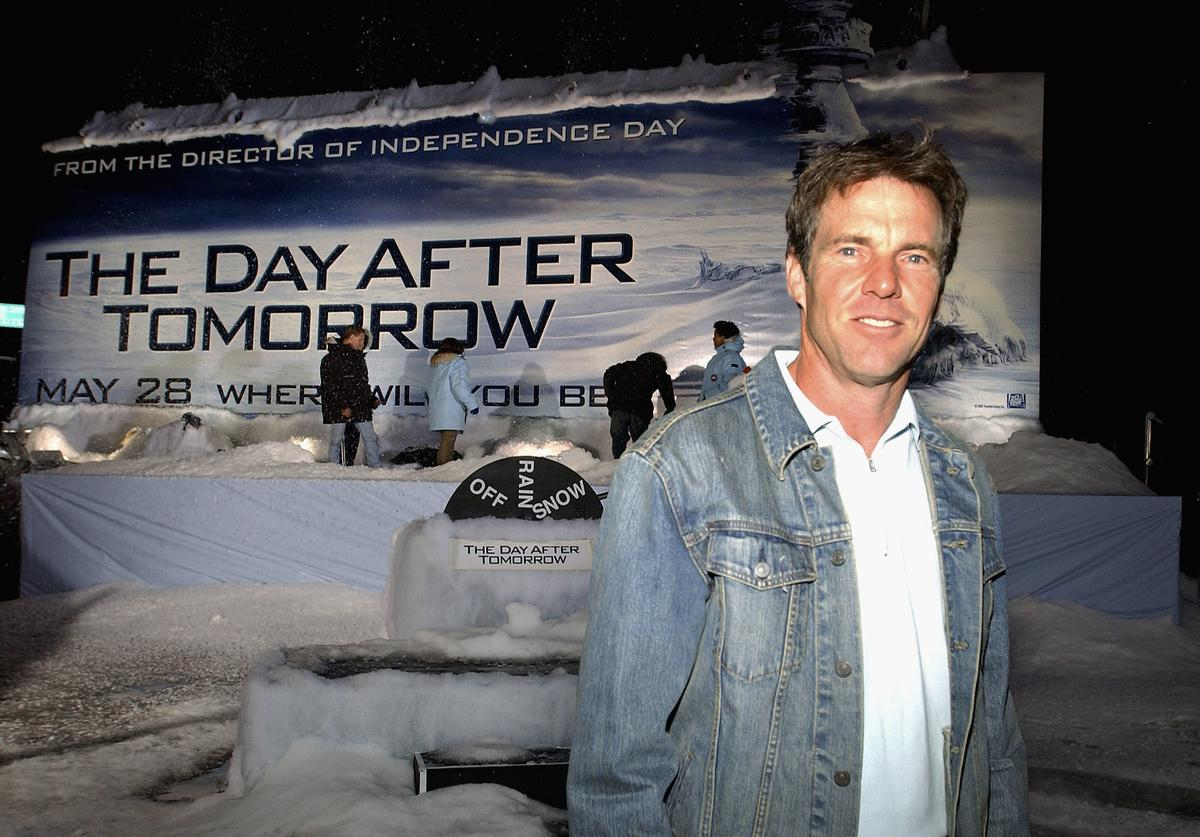 Actor Dennis Quaid attends the unveiling of the first ever 'weather billboard' which produced rain and snow to promote the new 20th Century Fox global warming drama 'The Day After Tomorrow' on May 4, 2004 on the Sunset Strip in Hollywood, California.