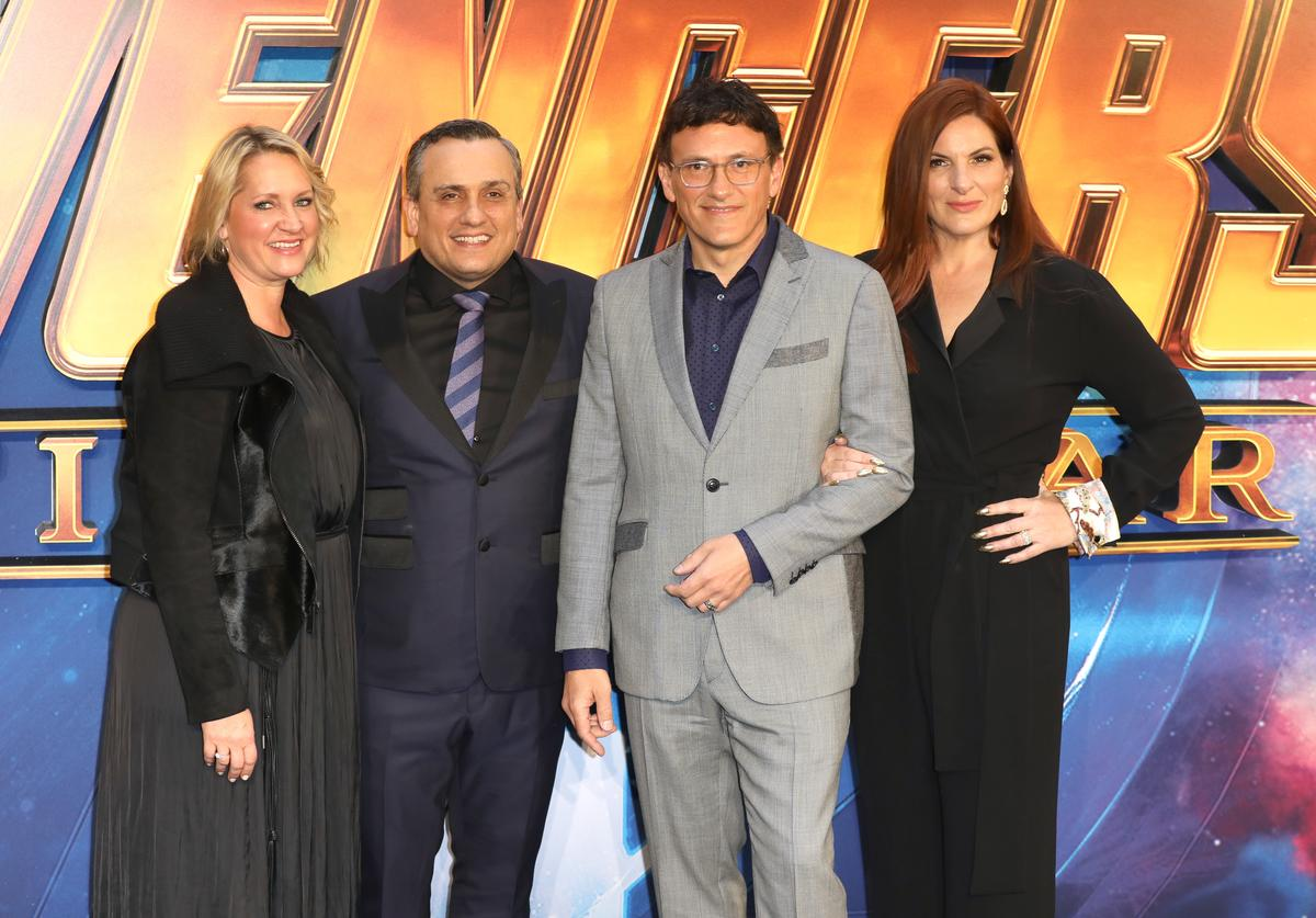 Directors Joe Russo (second left) and Anthony Russo (second right) attends the UK Fan Event for 'Avengers Infinity War' at Television Studios White City on April 8, 2018 in London, England.