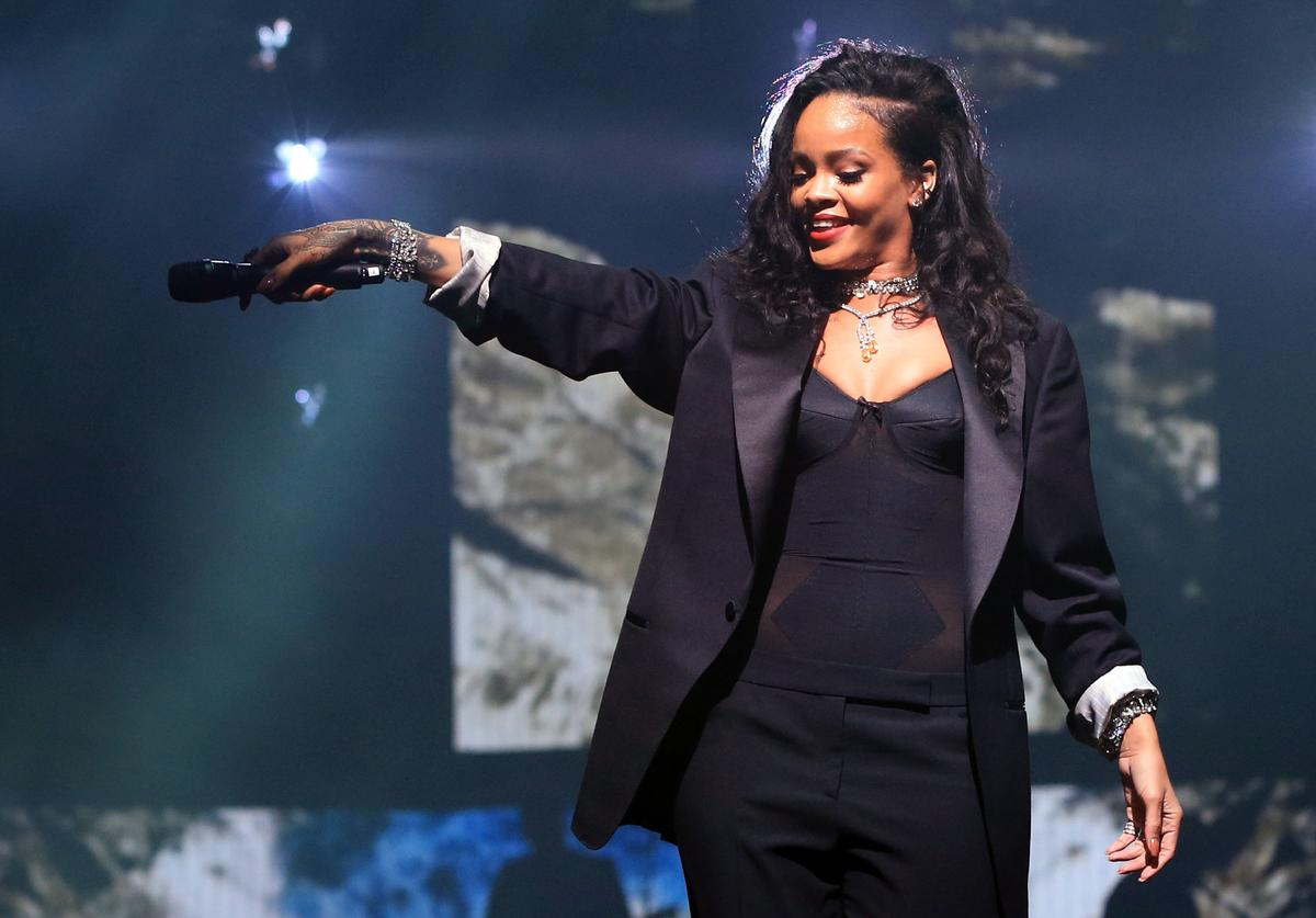 Rihanna performs onstage during DirecTV Super Saturday Night hosted by Mark Cuban's AXS TV and Pro Football Hall of Famer Michael Strahan at Pendergast Family Farm on January 31, 2015 in Glendale, Arizona
