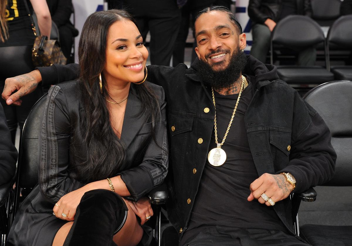 Nipsey Hussle and Lauren London attend a basketball game between the Los Angeles Lakers and the Portland Trail Blazers at Staples Center on November 14, 2018 in Los Angeles, California.