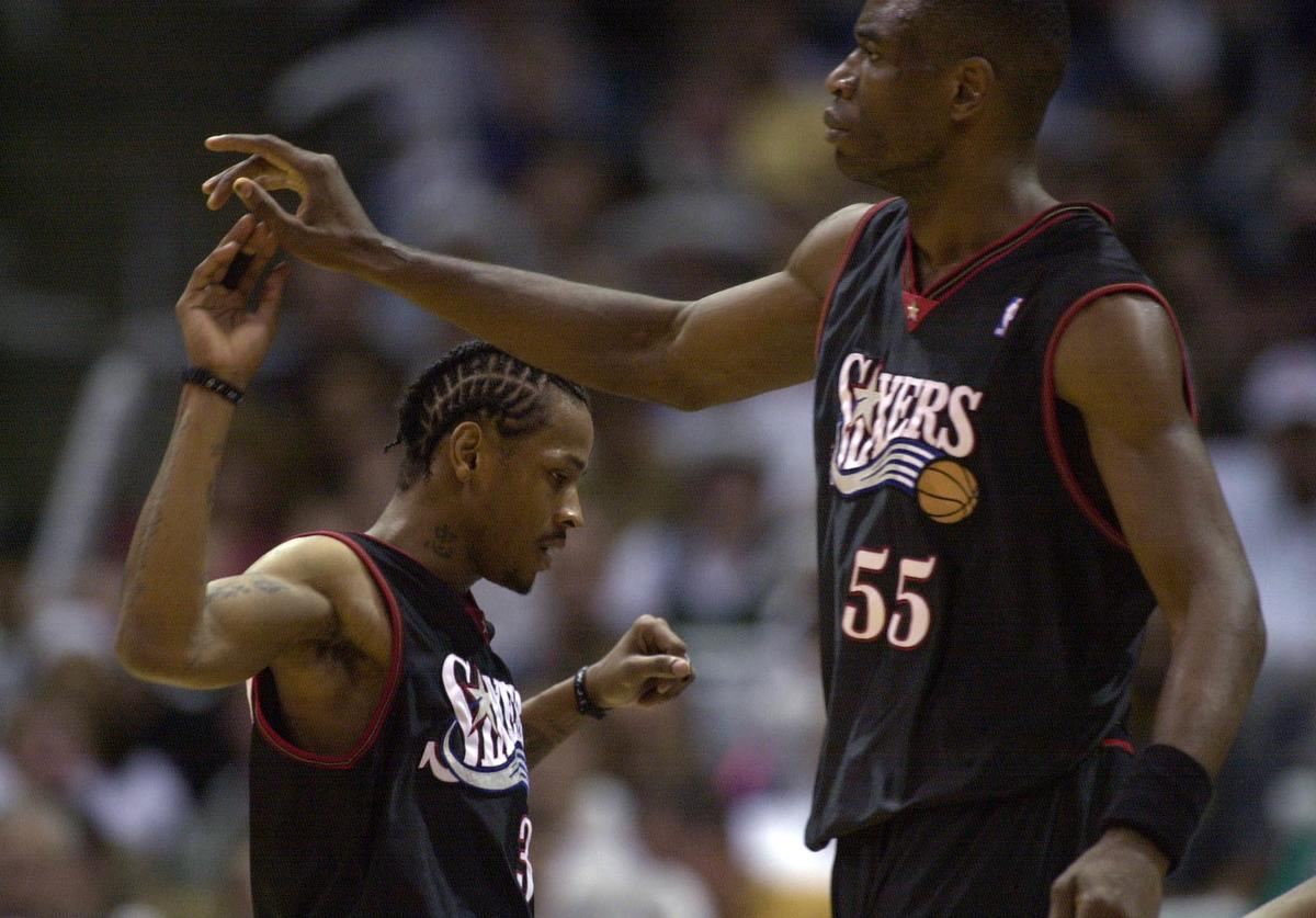 Allen Iverson #3 and Dikembe Mutombo #55 of the Philadelphia 76ers celebrate in game four of the eastern conference finals against the Milwaukee Bucks at the Bradley Center in Milwaukee, Wisconsin.
