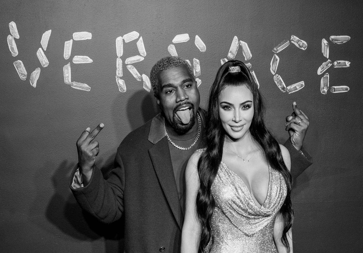 Kanye West and Kim Kardashian West attend the the Versace fall 2019 fashion show at the American Stock Exchange Building in lower Manhattan on December 02, 2018 in New York City.