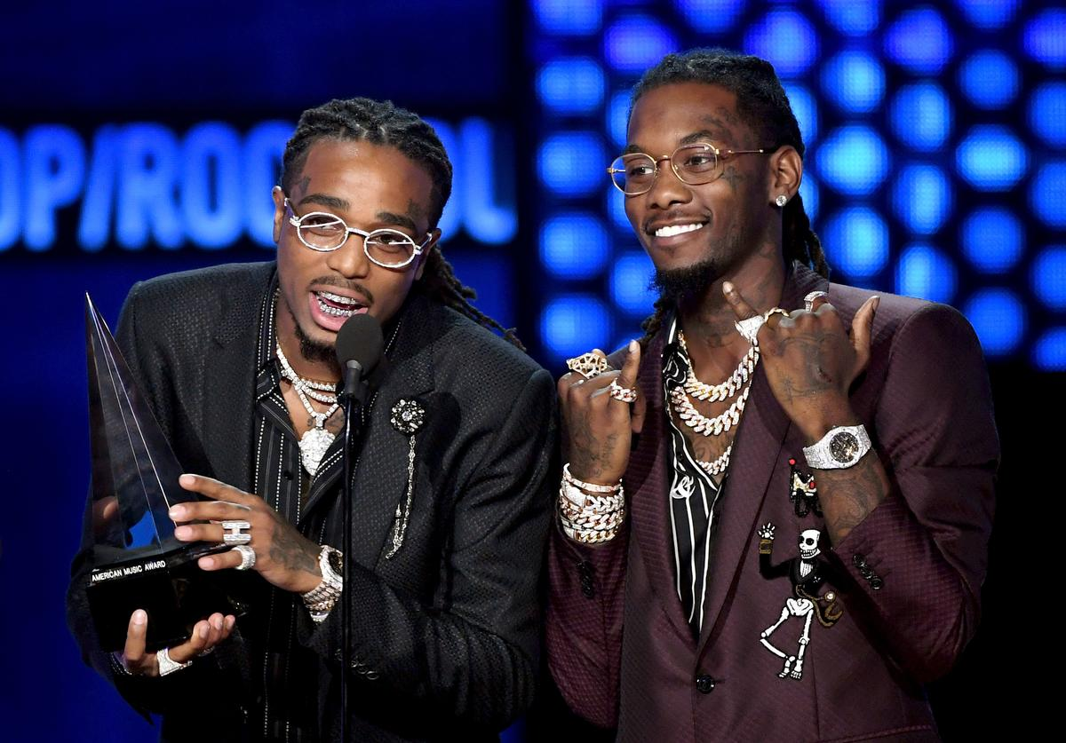 Quavo (L) and Offset of Migos accept Favorite Duo or Group - Pop/Rock onstage during the 2018 American Music Awards at Microsoft Theater on October 9, 2018 in Los Angeles, California