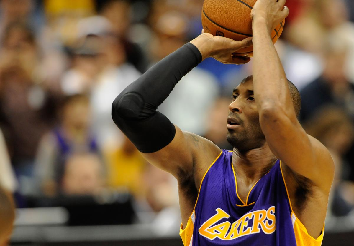 Kobe Bryant #24 of the Los Angeles Lakers shoots a free throw to tie Michael Jordan on the all-time scoring list during the second quarter of the game against the Minnesota Timberwolves on December 14, 2014 at Target Center in Minneapolis, Minnesota
