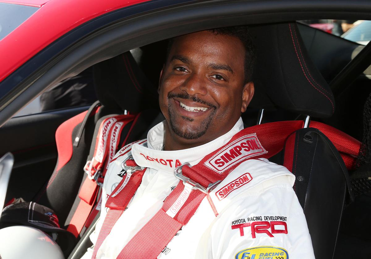 Alfonso Ribeiro waits for the start of the practice session for the 42nd Toyota Grand Prix of Long Beach Press Day on April 5, 2016 in Long Beach, California.